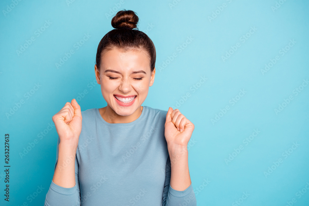 Fototapeta Close up photo beautiful amazing cute she her lady eyes closed crazy hold hands arms raised yelling goal funny funky trendy stylish hairstyle wear sweater pullover isolated blue bright background