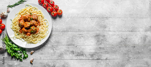 Spaghetti and meat balls with parsley and tomatoes. Fototapeta