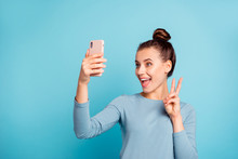 Close-up Portrait Of Her She Nice-looking Attractive Winsome Lovely Cheerful Optimistic Girl Holding In Hand Cell Making Selfie Showing V-sign Isolated Over Bright Vivid Shine Turquoise Background