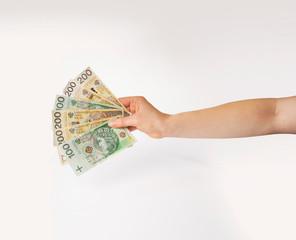 Dłoń trzymająca wachlarz pieniędzy