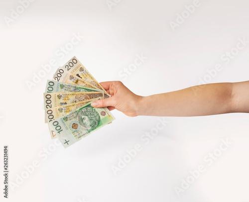 Fototapeta Dłoń trzymająca wachlarz pieniędzy obraz