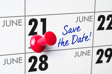 Wall calendar with a red pin - June 21
