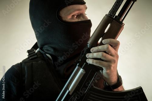 Photo  Guard, man armed with shotgun and bulletproof vest