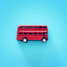 London Traditional Red Double Decker Bus Over Blue Background.
