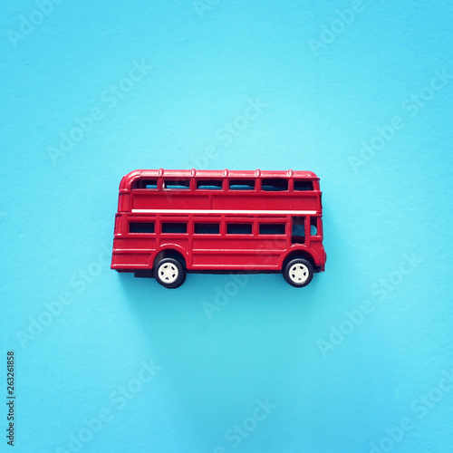 Stampa su Tela London traditional red double decker bus over blue background.