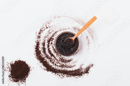 Cosmetic coffee scrub in jar with wooden spoon - 263263889
