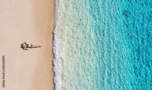 Valokuva  Aerial view of a girl on the beach on Bali, Indonesia