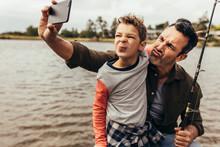 Man Taking Selfie With His Kid...