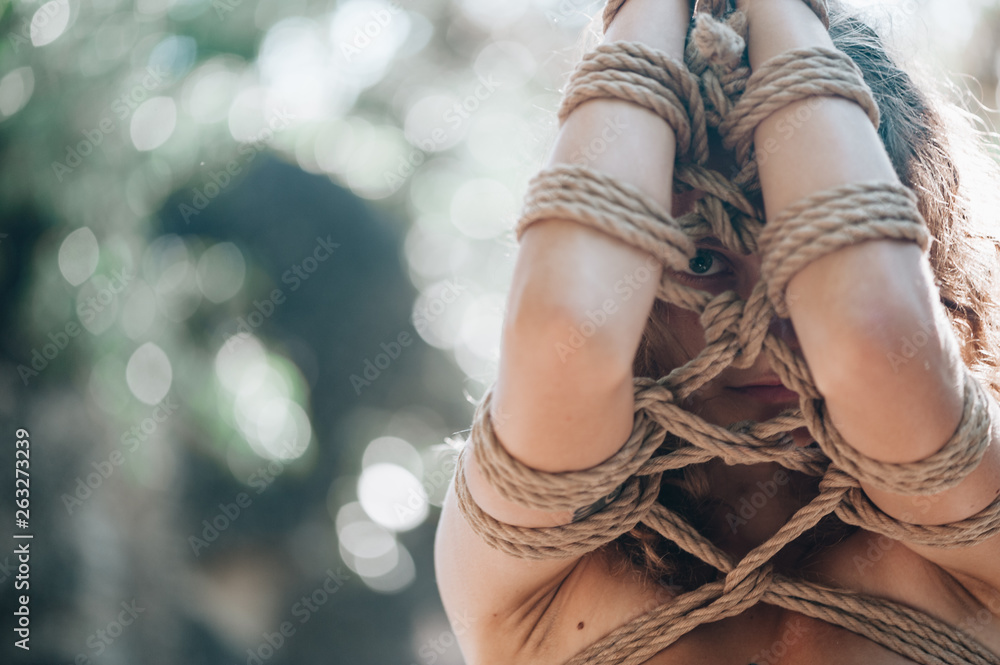 Fototapety, obrazy: Woman bound with a rope in Japanese technique shibari outdoors
