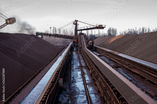 Fotografia, Obraz  delivery of enriched iron ore pellets to the warehouse using a belt conveyor