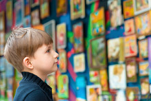 The Boy Looks At The Paintings...