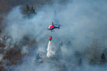 Helicopter Extinguishing Wildfire. Bergen, Norway.