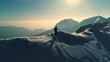 Aerial - Young man hiking on top of snowy mountain in winter