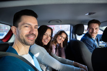 Smiling People Sitting In Car