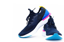 Pairs Of Blue Sport Shoes For Running On Isolated White Background