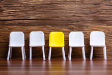 Empty Small Chair In Row On Wooden Background
