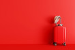 canvas print picture - Suitcase with hat and sunglasses on red background. travel concept. minimal style. 3d rendering
