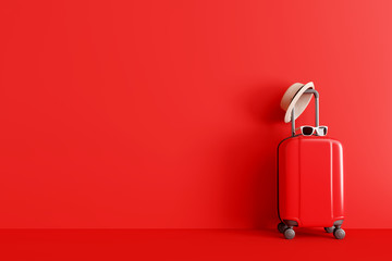 Suitcase with hat and sunglasses on red background. travel concept. minimal s...