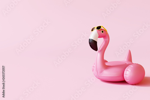 Obraz na plátně Flamingo float with sunglasses on pastel pink background