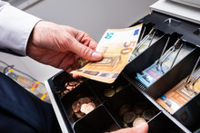 Euro Banknotes And Coins In Ca...