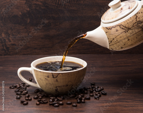 Fotografie, Obraz  Coffee pours into Coffe Cup with Coffe Pot with Coffee Beans