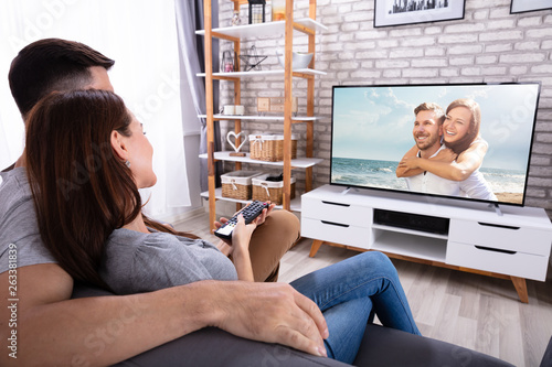 Fototapety, obrazy: Couple Watching Television At Home
