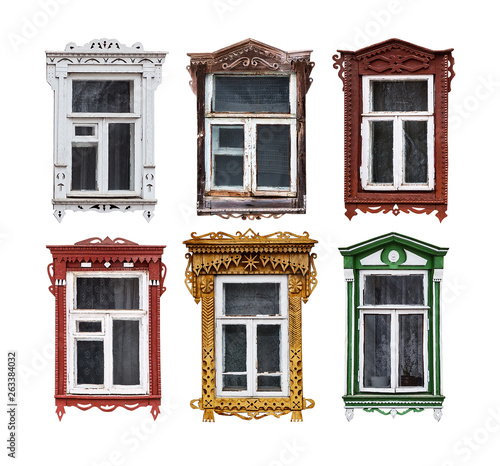 Set of windows with the wooden carved architrave in the house in the old Russian town Canvas Print