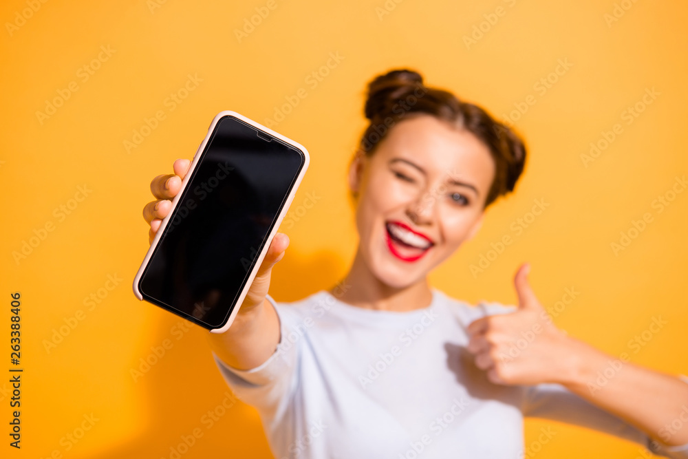 Fototapeta Close up photo of funky energetic student showing her mobile phone agreement appreciation wearing light cotton outfit on colorful background