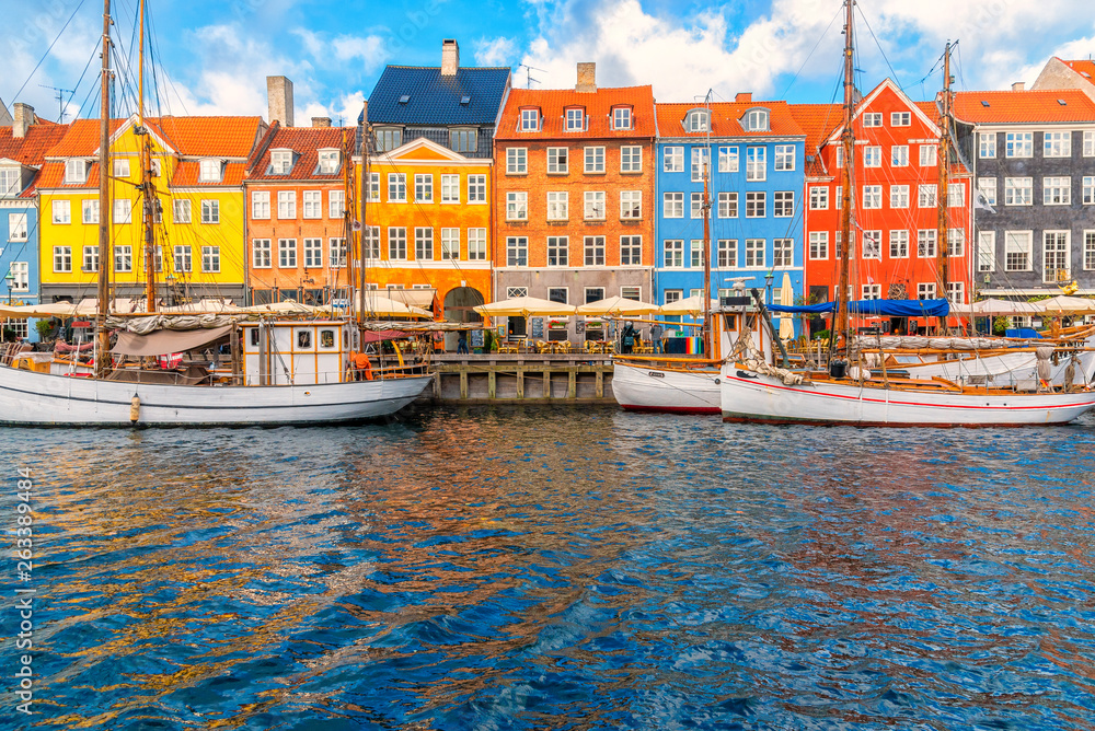 Fototapety, obrazy: Nyhavn area of popular bar and restaurant at beautiful blue sky, with colorful facades of old houses and old ships in the Old Town of Copenhagen, capital of Denmark.