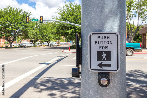 Obraz na plátne push button for crosswalk sign ona road in the USA