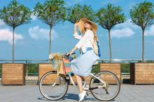 Smiling Woman Is Cycling Aroun...
