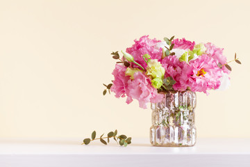 Beautiful flowers bouquet in vase for Mothers day greeting card.