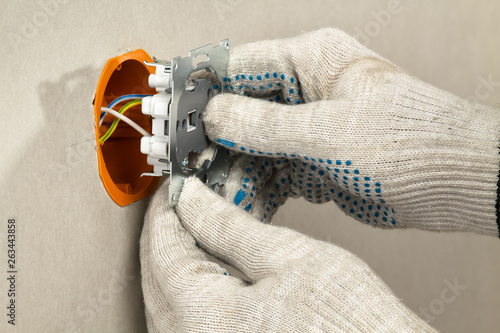 installing an electrical outlet in the socket box on the plasterboard wall