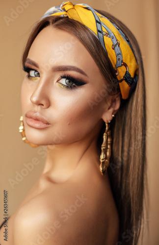 sensual girl with dark hair and evening makeup, with silk headband Wallpaper Mural