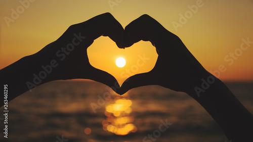 plakat Female hands in heart shape