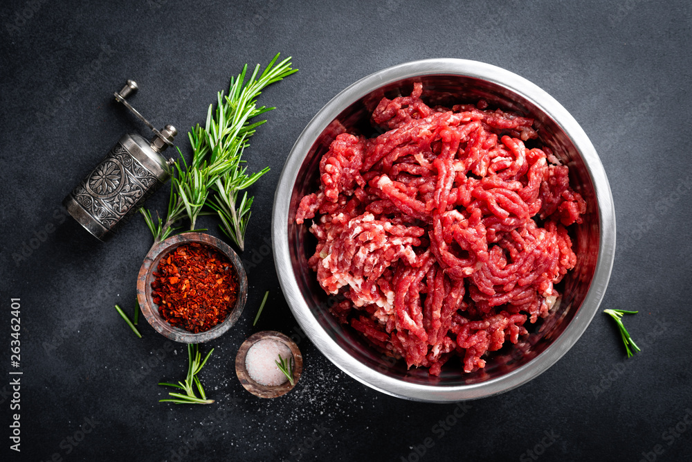 Fototapeta Mince. Ground meat with ingredients for cooking