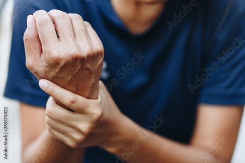 Cuadros en Lienzo  Close up young woman wrist pain, health care concept