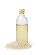 Bottle With Traditional Japanese Rice Vinegar And A Heap Of Rice