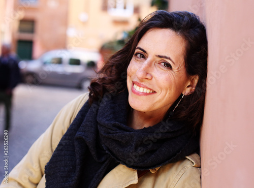 Outdoor portrait of happy smiling woman