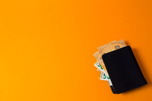 Black Wallet With Euro Money On A Yellow Background