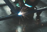 Worker welding steel frame with MIG technology - 263534005