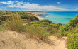 Summer beach.Torre Guaceto Nature Reserve: panoramic view of the coast from the dunes.Italy (Apulia). Mediterranean maquis: a nature sanctuary between the land and the sea.