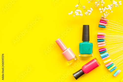 Cuadros en Lienzo decorative cosmetics set with flower, nail polish and palette for manicure on ye