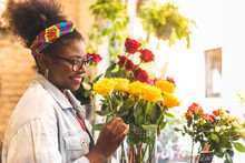 Afro American Teenage Girls Smelling Yellow Rose Flowers.
