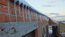Icicle On A Shed Roof In Winte...