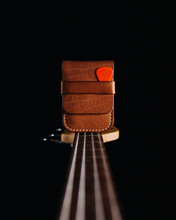 Leather Accessories On Guitar, Black Background
