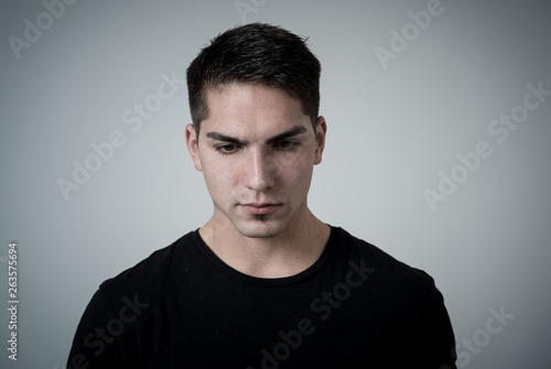 Fototapety, obrazy: Portrait of sad and depressed young man feeling upset. Human expressions and negative emotions