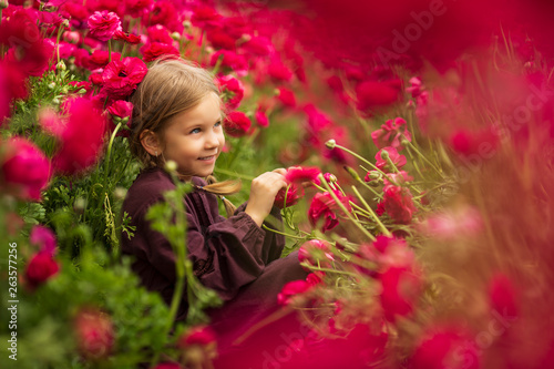 Aluminium Prints Flower shop cute girl in field of wildflowers in the open air. The girl in the buttercup