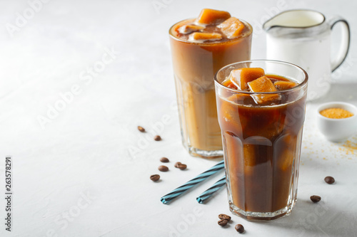 Fotografie, Obraz  Ice coffee in a tall glass with cream poured over and coffee beans