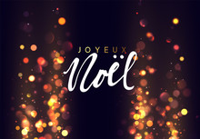 French Text Joyeux Noel. Christmas Background With Golden Lights Bokeh.